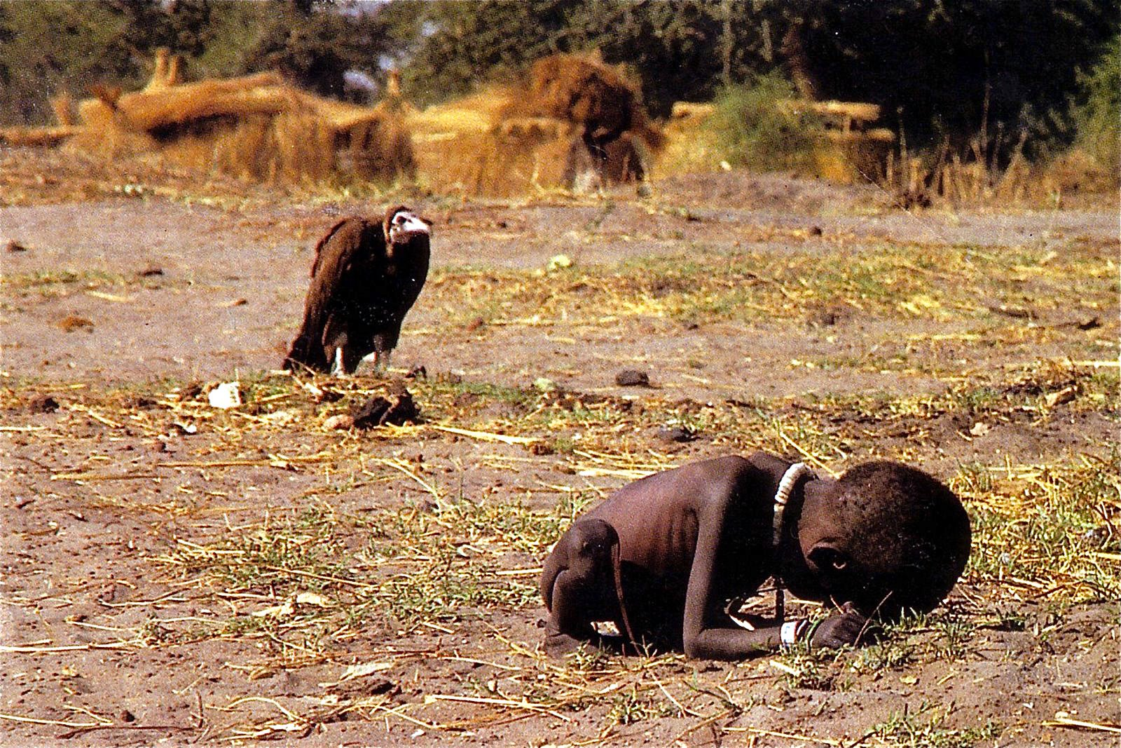 africa child starving vulture